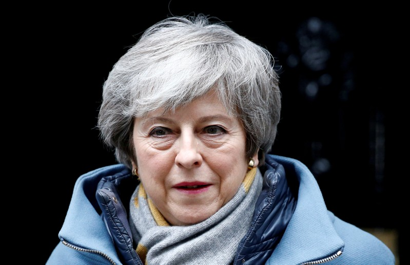 FILE PHOTO: British PM May walks outside Downing Street in London