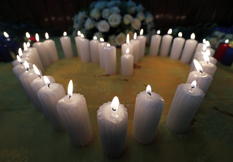Candles arranged in a heart-shape at a prayer session, as relatives mourn their kin, during a commemoration ceremony for the victims at the scene of the Ethiopian Airlines Flight ET 302 plane crash, at the Kenyan Embassy in Addis Ababa