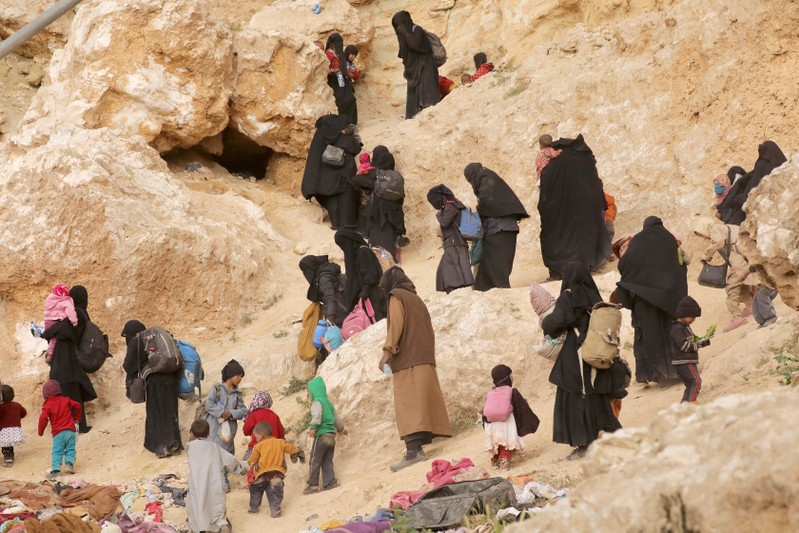 FILE PHOTO: Surrendering families of Islamic State militants in the village of Baghouz, Deir Al Zor province, Syria