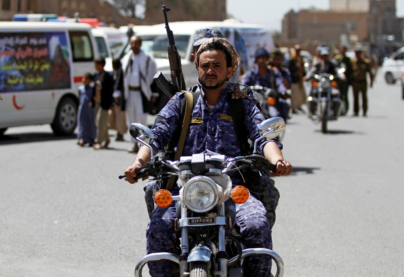 A Houthi security officer rides a motorbike during a funeral of people killed by an air strike last week in the northwestern province of Hajja, in Sanaa