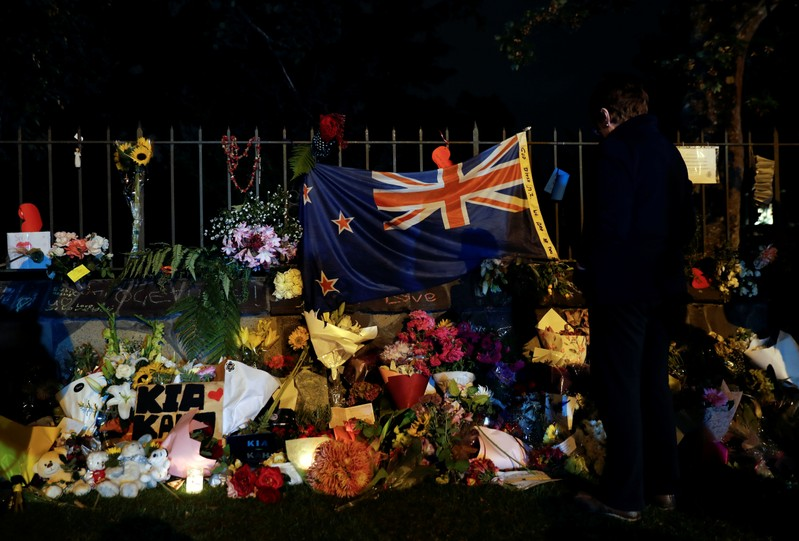 People pay their respects at a memorial site for victims of the mosque shootings at the Botanic Gardens in Christchurch