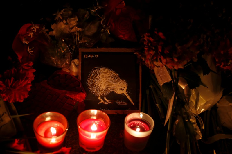 Candles are flowers placed at a memorial site for victims of the mosque shootings are pictured at the Botanic Gardens in Christchurch
