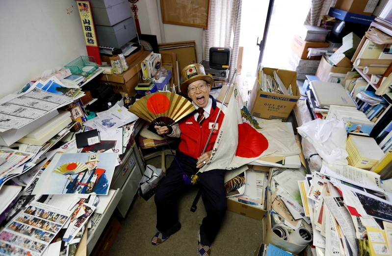 FILE PHOTO: Naotoshi Yamada poses for a photo at his office in Tokyo