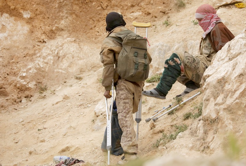 FILE PHOTO: Injured Islamic state militants are seen in the village of Baghouz, Deir Al Zor province