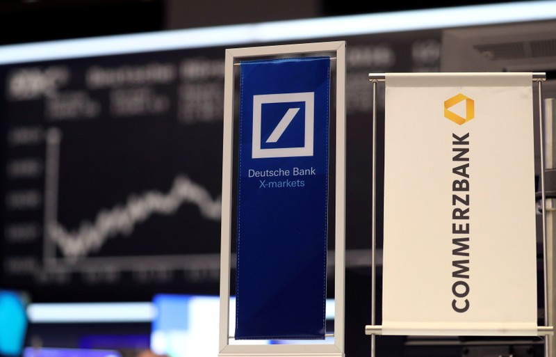 FILE PHOTO: FILE PHOTO: Banners of Deutsche Bank and Commerzbank are pictured in front of the German share price index, DAX in Frankfurt