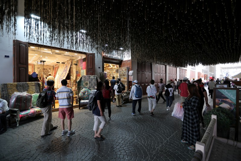 FILE PHOTO: Locals and visitors are seen shopping in local area in downtown Manama, Bahrain