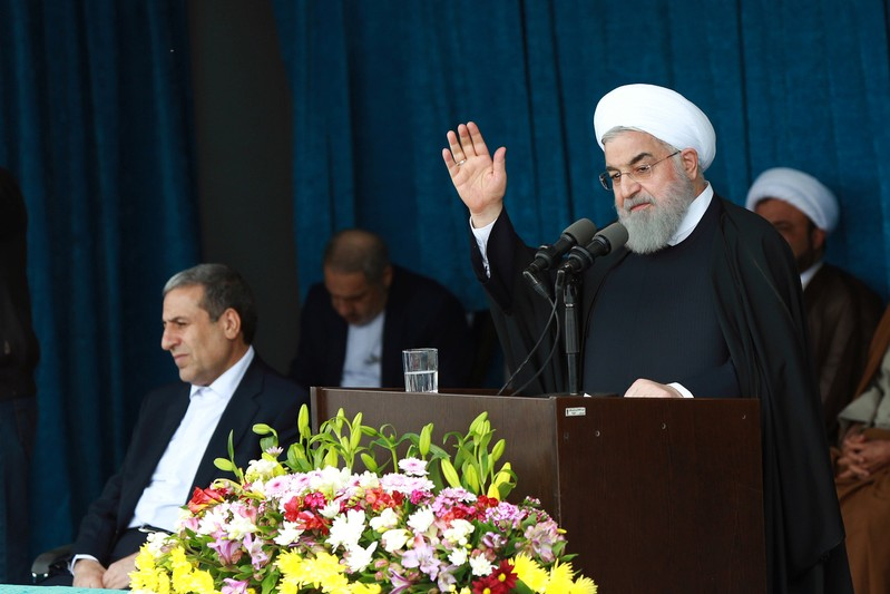 Iranian President Rouhani gestures to the crowd at a public speech in Bandar Kangan