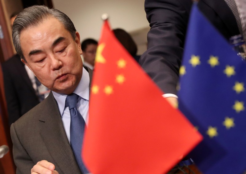 Chinese Foreign Minister Wang Yi attends a meeting with EU High Representative for Foreign Affairs and Security Policy Federica Mogherini in Brussels