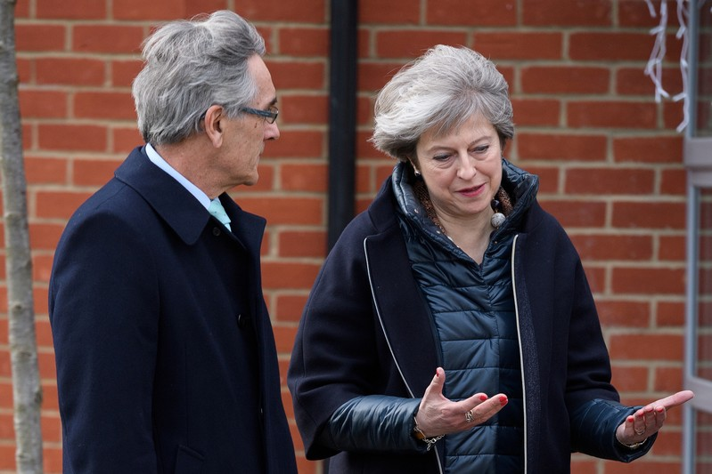 British Prime Minister Theresa May talks with Conservative MP for Wokingham John Redwood during a visit to a new housing development in Wokingham