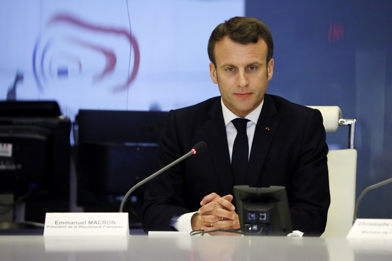 French President Emmanuel Macron presides over an emergency crisis meeting at the Interior Ministry in Paris