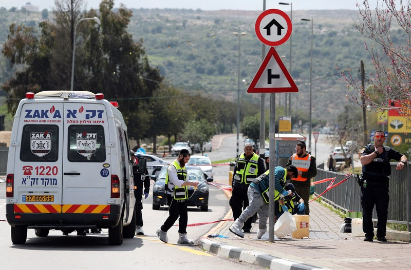 Israeli forensic police inspect the scene of Palestinian shooting attack near the Jewish settlement of Ariel, in the occupied West Bank