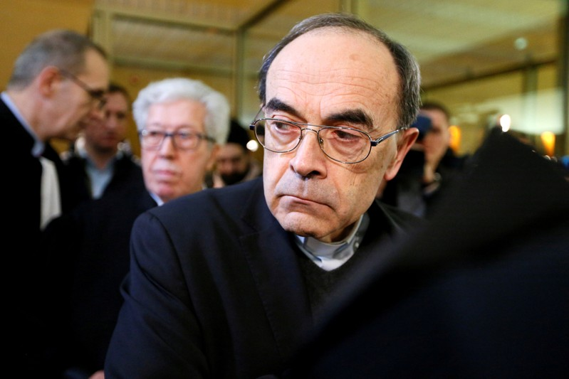 FILE PHOTO: Cardinal Philippe Barbarin, Archbishop of Lyon, arrives to attend his trial at the courthouse in Lyon