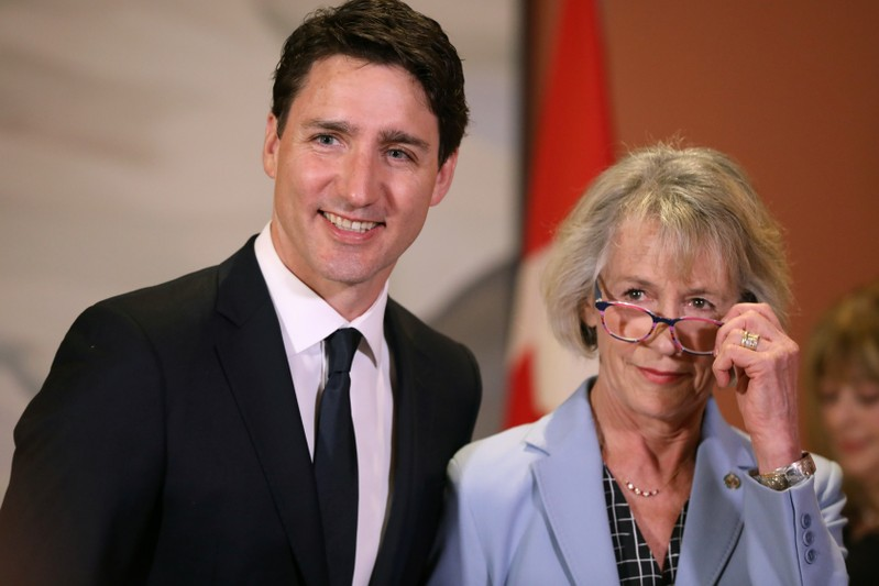 Canada's Prime Minister Justin Trudeau poses with Joyce Murray after she was sworn-in during a cabinet shuffle at Rideau Hall in Ottawa