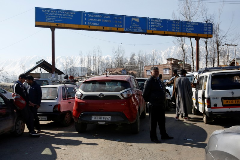 Traffic is stopped as the Indian Central Reserve Police Force (CRPF) convoy moves along a national highway in Qazigund