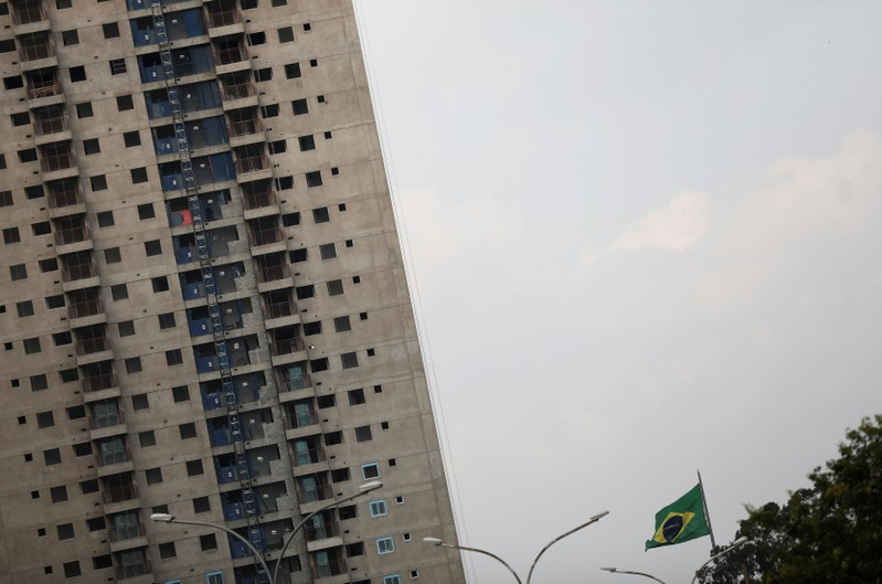Brazilian flag is seen next to a residential building under construction in Sao Paulo