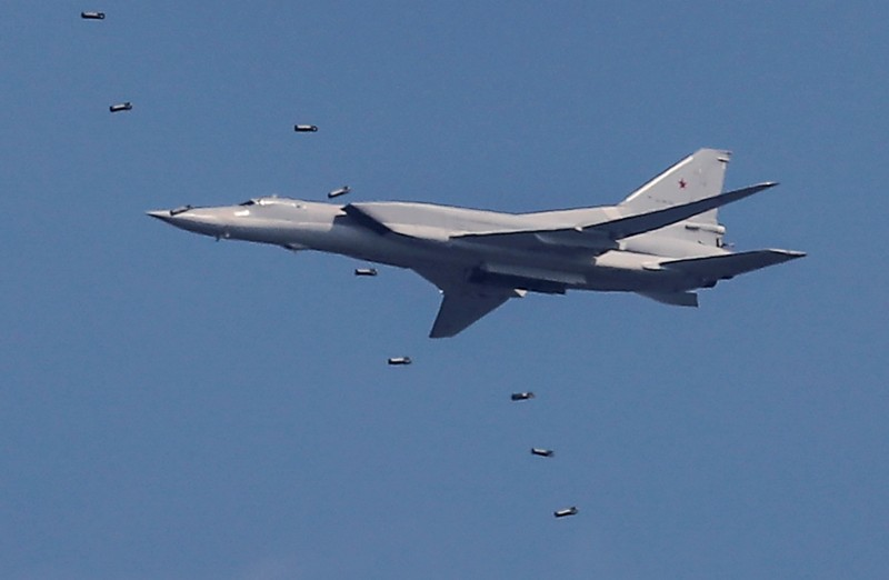 A Tupolev Tu-22M3 strategic bomber drops bombs during the Aviadarts competition at the Dubrovichi range outside Ryazan
