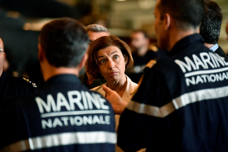 FILE PHOTO - French Defence Minister Florence Parly stands with marine officers as she visits the aircraft carrier