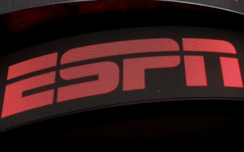 FILE PHOTO: The ESPN logo is seen on an electronic display in Times Square in New York City