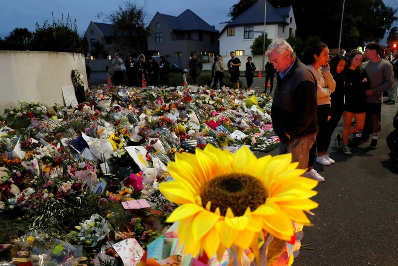 People visit a memorial site for victims of Friday's shooting, in front of the Masjid Al Noor mosque in Christchurch