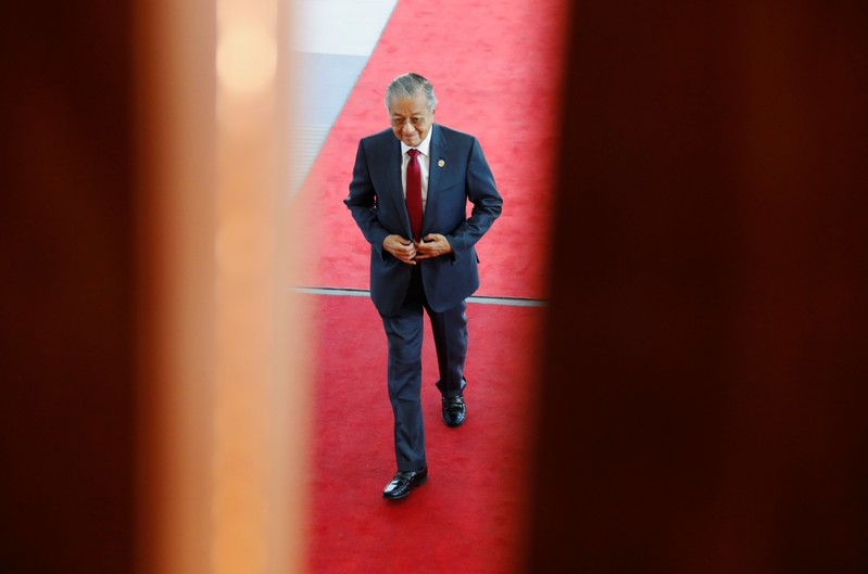 FILE PHOTO: Malaysia's Prime Minister Mahathir Mohamad arrives at APEC Haus, during the APEC Summit in Port Moresby, Papua New Guinea