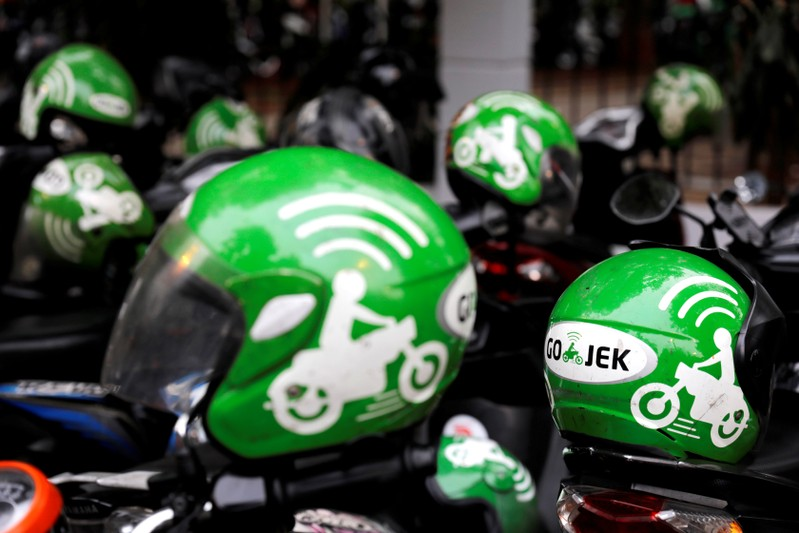 FILE PHOTO: Go-Jek driver helmets are seen during the Go-Food festival in Jakarta