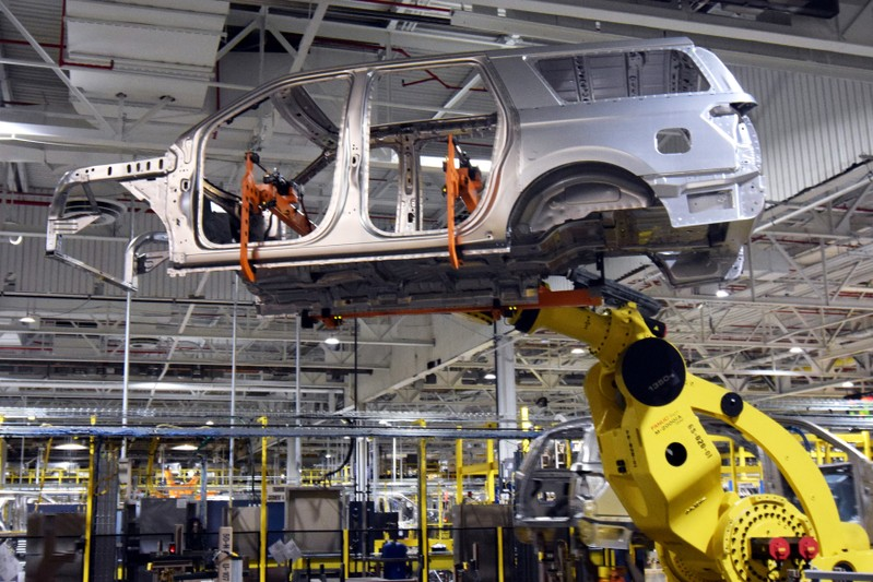 FILE PHOTO: A large robot nicknamed ÒKongÓ lifts the body of a Ford Expedition SUV at FordÕs Kentucky Truck Plant in Louisville