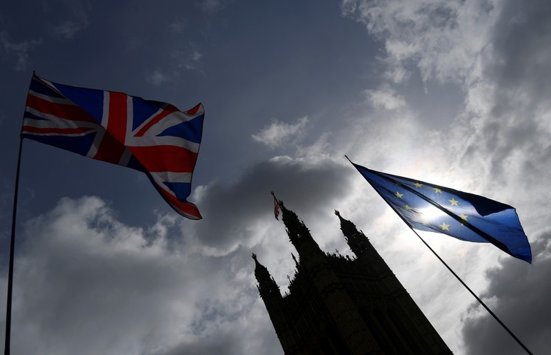 The British union flag and the EU flag are seen flying near the Houses of Parliament, in London, Britain
