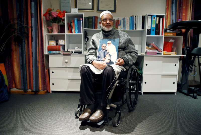 Al Noor mosque shooting survivor Farhid Ahmed poses with a photo of his wife Husna, who was killed in the attack, after an interview with Reuters in Christchurch, New Zealand