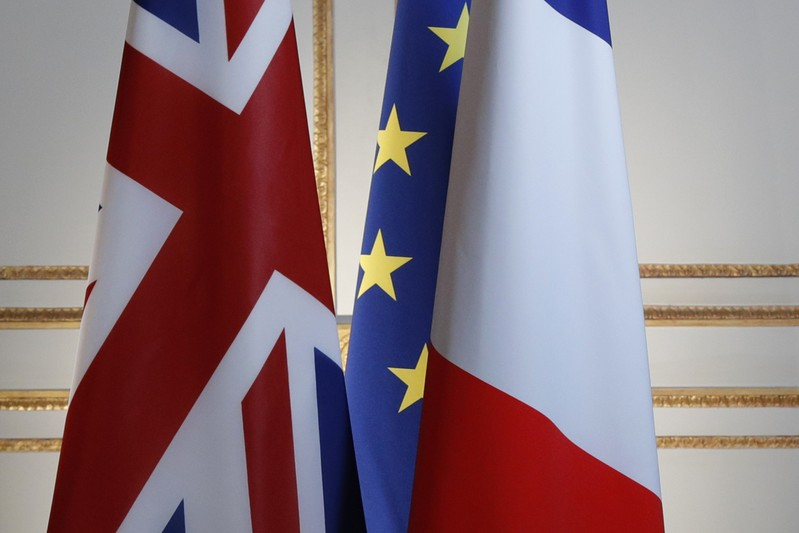 Britain, European and French flags are seen before a news conference at the Elysee Palace in Paris