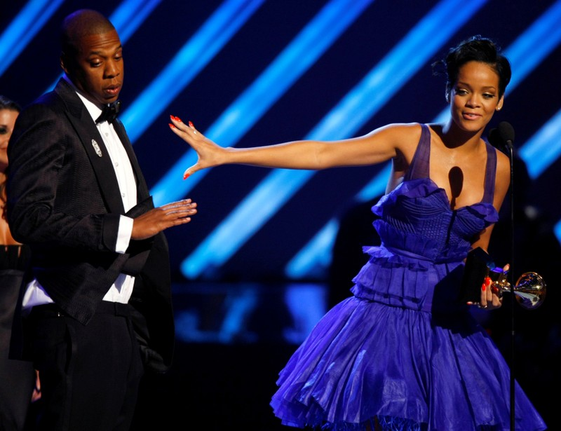 FILE PHOTO: Rihanna and Jay-Z react on stage after winning Grammy for best rap/sung collaboration for