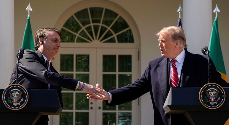 U.S. President Donald Trump and Brazil's President Jair Bolsonaro hold a joint news conference at the White House in Washington