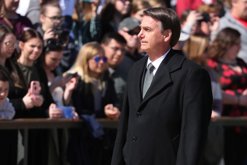 Brazil's President Jair Bolsonaro takes part in wreath laying at the Tomb of Unknown Soldier at Arlington National Cemetery