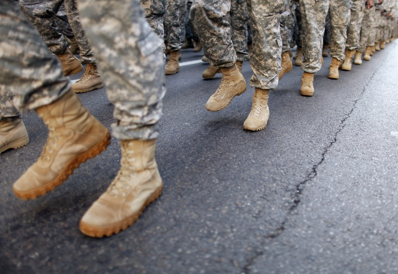 FILE PHOTO - Members of the Army march up 5th Avenue during the Veterans Day Parade in New York