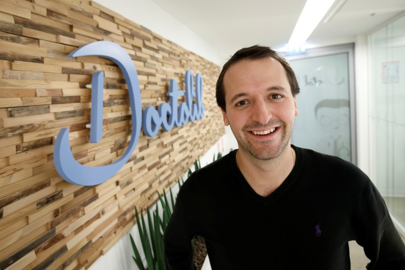 FILE PHOTO:  Stanislas Niox-Chateau, Co-Founder & CEO of  Doctolib, poses at the entrance of the company's headquarters in Paris