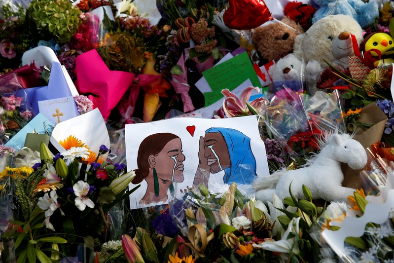 Flowers and cards are seen at the memorial site for the victims of Friday's shooting, outside Al Noor mosque in Christchurch