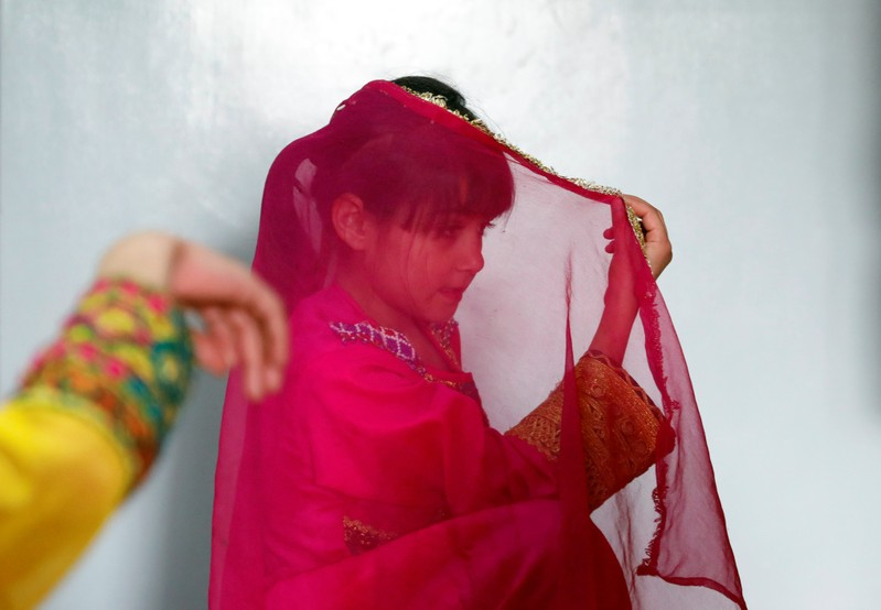 An Afghan girl practices a traditional dance at an Afghan Child Education and Care Organization center (AFCECO) in Kabul