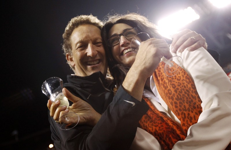 FILE PHOTO: Giants President Baer and wife Pam celebrate after Giants defeated Padres in MLB game in San Francisco