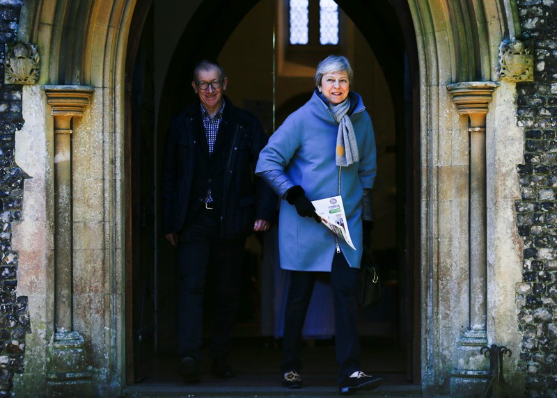 Britain's Prime Minister Theresa May and her husband Philip leave church in Sonning