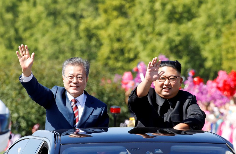 FILE PHOTO: South Korean President Moon Jae-in and North Korean leader Kim Jong Un wave during a car parade in Pyongyang