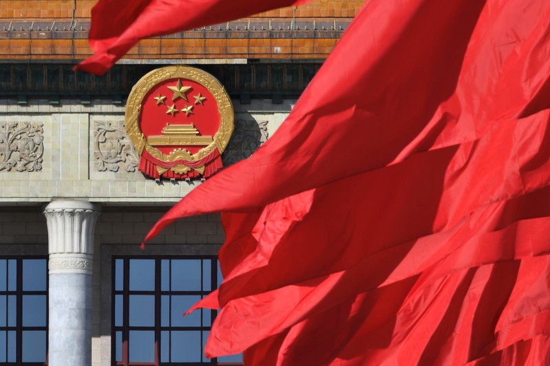 Red flags flutter outside the Great Hall of the People during the closing session of the Chinese People's Political Consultative Conference (CPPCC) in Beijing