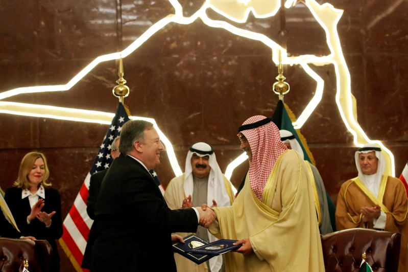 U.S. Secretary of State Mike Pompeo shakes hands with Kuwait's Foreign Minister Sheikh Sabah Al-Khalid Al-Sabah in Kuwait
