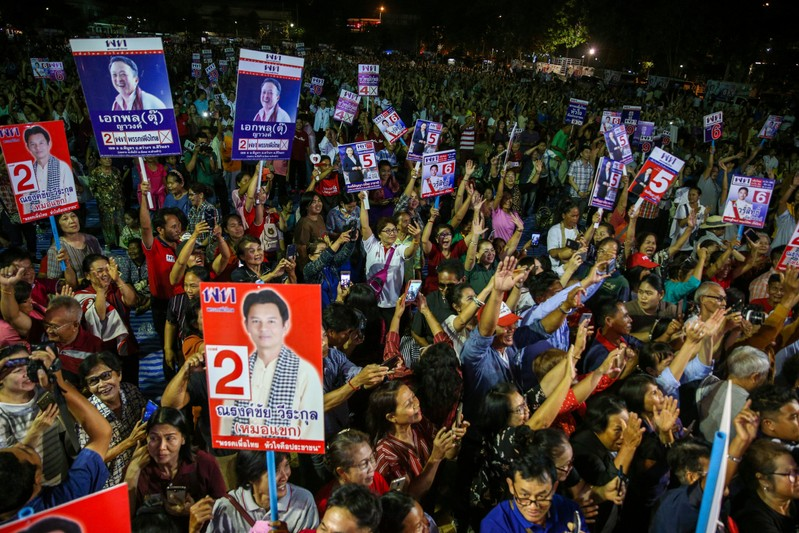 Supporters of Pheu Thai Party attend an election campaign in Ubon Ratchathani Province