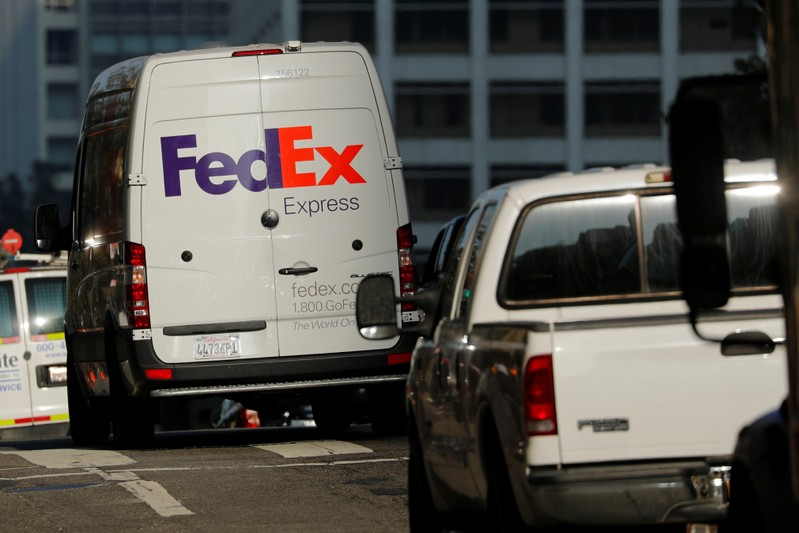 A Federal Express delivery truck is shown in downtown Los Angeles