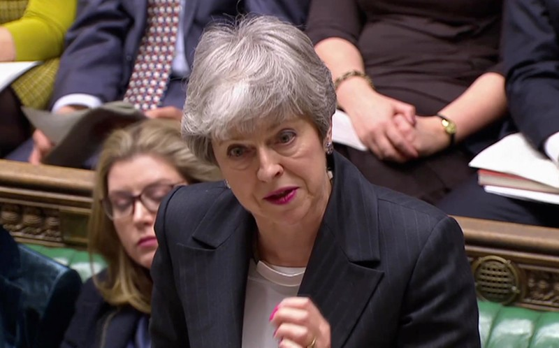 Britain's Prime Minister Theresa May answers questions in the Parliament in London