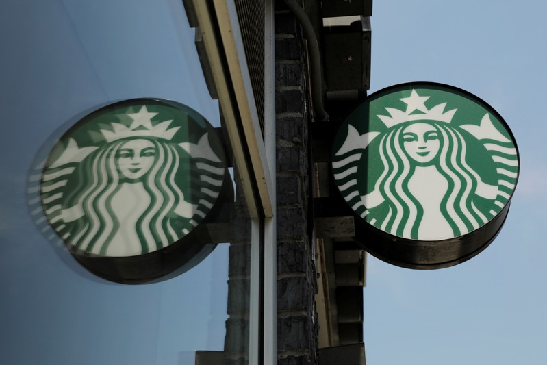 A Starbucks logo hangs outside of one of the 8,000 Starbucks-owned American stores that will close around 2 p.m. local time on Tuesday as a first step in training 175,000 employees on racial tolerance in the Brooklyn borough of New York