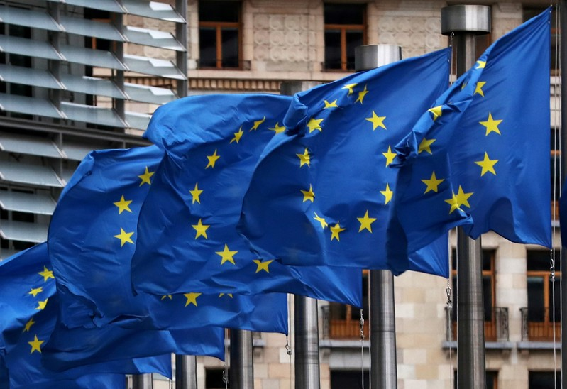 FILE PHOTO: EU flags fly outside the European Commission headquarters in Brussels
