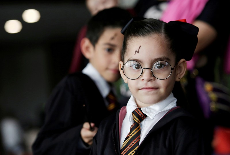 Fans dressed as Harry Potter participate in an event attempting to beat the previous Guinness World Record for the largest gathering of people dressed as Harry Potter, in Monterrey, Mexico