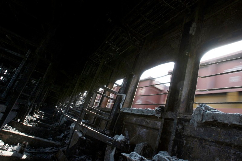 FILE PHOTO: A view of a burnt carriage of Samjhauta Express train in Deewana near Panipat town