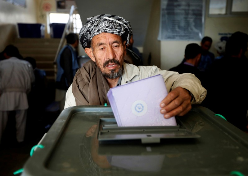 FILE PHOTO: An Afghan man casts his vote during the parliamentary election at a polling station in Kabul, Afghanistan