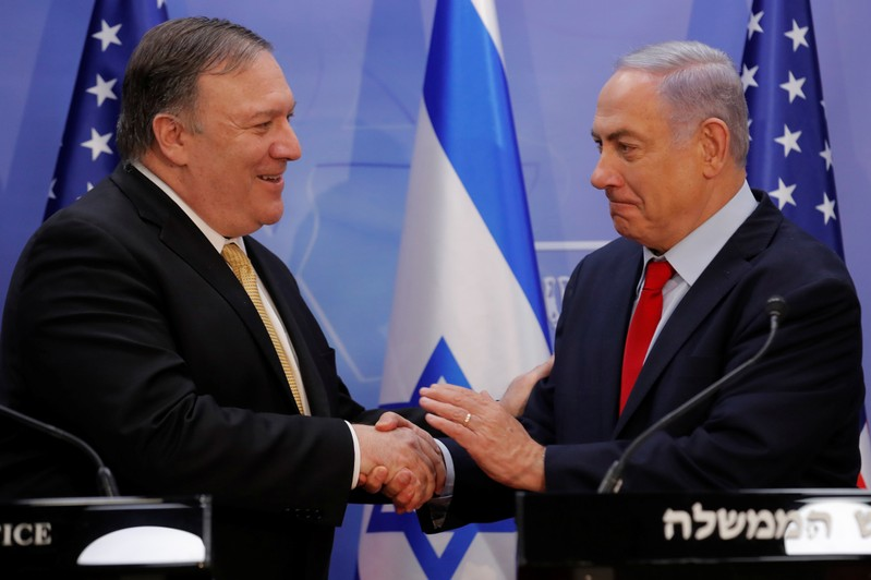 U.S. Secretary of State Mike Pompeo and Israeli Prime Minister Benjamin Netanyahu shake hands as they deliver joint statements during their meeting in Jerusalem